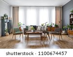 wooden table with flowers... | Shutterstock . vector #1100674457