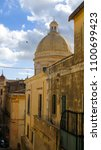 Small photo of View of the dome of the Baroque church Cathedral of San Nicola di Mira in the center of Noto in the province of Syracuse in Sicily, Italy