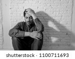 young depressed man sitting... | Shutterstock . vector #1100711693