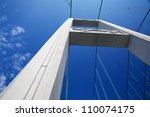 One of the Tacoma narrows bridge Towers against a nearly cloudless blue sky - stock photo