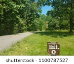 Small photo of asphalt bike or walking trail with zero mile marker