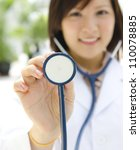 Asian medical student with stethoscope in hand - stock photo