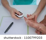 elderly woman with blood... | Shutterstock . vector #1100799203