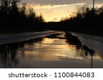 street with reflective puddles... | Shutterstock . vector #1100844083