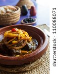 A Moroccan tajine dish with meat, onion and raisin - stock photo
