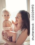 mother playing with baby...   Shutterstock . vector #110104493