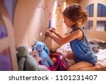 side view of girl drawing with... | Shutterstock . vector #1101231407