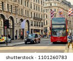 red double decker bus and black ...   Shutterstock . vector #1101260783
