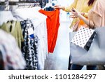 unrecognizable women buying... | Shutterstock . vector #1101284297