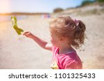 little  girl l at the beach... | Shutterstock . vector #1101325433