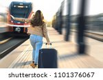 late from train. woman running... | Shutterstock . vector #1101376067