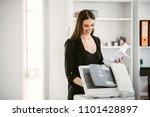business woman using a printer. ... | Shutterstock . vector #1101428897