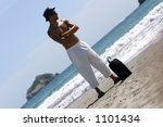 Man in the beach - stock photo