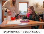 mother cleaning up after her...   Shutterstock . vector #1101458273