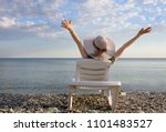 young girl in a hat lying on a... | Shutterstock . vector #1101483527