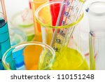 Laboratory glassware close up on white background - stock photo