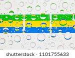 flags  of gabon behind a glass... | Shutterstock . vector #1101755633