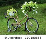 Vintage garden bicycle - stock photo