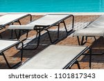 sun loungers by the pool | Shutterstock . vector #1101817343