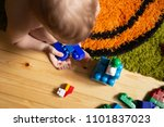 baby boy playing with toys | Shutterstock . vector #1101837023
