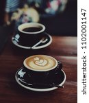 coffee latte in coffee shop... | Shutterstock . vector #1102001147