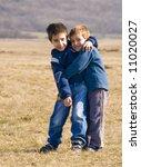 boys hugging | Shutterstock . vector #11020027