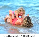 mother with daughter on beach | Shutterstock . vector #110203583