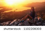 happy woman in the mountains... | Shutterstock . vector #1102208303