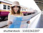 asian traveler woman looking... | Shutterstock . vector #1102262207