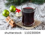 fresh mulled wine with christmas decoration - stock photo