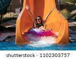 happy woman going down on the... | Shutterstock . vector #1102303757