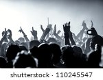 cheering crowd in front of bright stage lights - stock photo