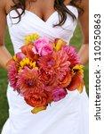 Bride Holding Wedding Bouquet...