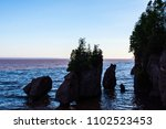 Small photo of The Hopewell Rocks in Fundy Bay silhouetted in the evening light