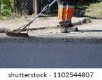 worker using tool to smooth... | Shutterstock . vector #1102544807