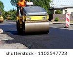 asphalt roller machine on the... | Shutterstock . vector #1102547723