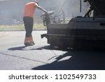 asphalt  pavers on the road | Shutterstock . vector #1102549733