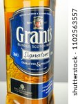 Small photo of KWIDZYN, POLAND - APRIL 7, 2018: Grants blended whiskey isolated on gradient background. Grants has been produced by William Grant and sons in Scotland since 1887
