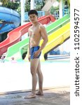 """Small photo of Udonthani, Thailand ; May 26, 2018 - Male Contestants for Beauty Handsome Pageant contest in Swim Suit to present body perfect in Theme Water Park for """"Mister Star Thailand 2018 E-sarn"""""""