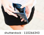 Woman Looks At The Purse On Th...