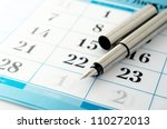 ink pen to mark the date in the calendar - stock photo