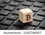 wooden block with bitcoin... | Shutterstock . vector #1102768307