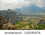 Meteora Valley from Greece, beautiful landscape with tall mountains and blue clouds - stock photo