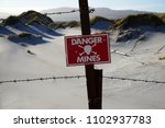 Small photo of Danger mines sign