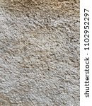 Small photo of Embossed decorative plaster.Svetlaya relief surface.Relief.