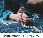 concentrated woman praying with ... | Shutterstock . vector #1102967297