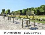 empry chairs in the jardin du... | Shutterstock . vector #1102984493
