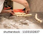 woman baker working in bakery... | Shutterstock . vector #1103102837