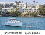 A pleasure craft moored of the coastline of Hamilton Harbour, Bermuda. - stock photo