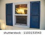 window reflection blue shutters ... | Shutterstock . vector #1103153543